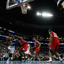 January 3, 2011; New Orleans, LA, USA; New Orleans Hornets point guard Chris Paul (3) drives past Philadelphia 76ers power forward Elton Brand (42) during the second half at the New Orleans Arena. The Hornets defeated the 76ers 84-77.  Mandatory Credit: Derick E. Hingle