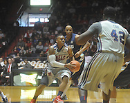 "Ole Miss guard Dundrecous Nelson (5) drives as East Tennessee State's Micah Williams (30) defends at the C.M. ""Tad"" Smith Coliseum in Oxford, Miss. on Saturday, December 18, 2010. Ole Miss won 71-50."