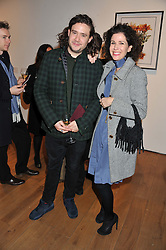 ADAM WAYMOUTH and MOLLIE DENT-BROCKLEHURST at the launch of the Krug Happiness Exhibition at The Royal Academy, 6 Burlington Gardens, London on 12th December 2011.