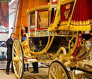 THE HAGUE - King Willem-Alexander looks at the Louwman Museum's restored glass coach glazen koets . The special carriage, the oldest of the royal stable department, the next time will be exhibited in the museum .COPYRIGHT ROYALS BY ROBIN/marco de swart<br /> DEN HAAG - Koning Willem-Alexander bekijkt in het Louwman Museum de gerestaureerde glazen koets. Het bijzondere rijtuig, de oudste uit het koninklijk staldepartement, wordt de komende tijd tentoongesteld in het museum. COPYRIGHT ROYALS BY ROBIN/marco de swart
