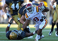 September 08 2012: Iowa State Cyclones running back James White (8)  almost fumbles the ball as he is hit by Iowa Hawkeyes linebacker Anthony Hitchens (31) and Iowa Hawkeyes defensive lineman Louis Trinca-Pasat (90) during the fourth quarter of the NCAA football game between the Iowa State Cyclones and the Iowa Hawkeyes at Kinnick Stadium in Iowa City, Iowa on Saturday September 8, 2012. Iowa State defeated Iowa 9-6.