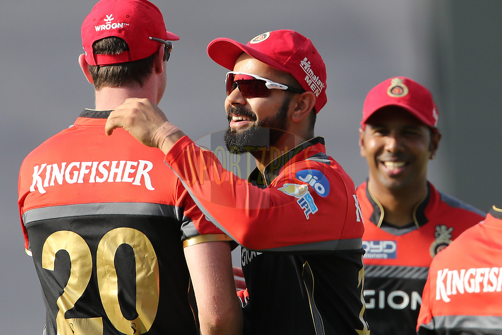 Royal Challengers Bangalore captain Virat Kohli congratulates Adam Milne of the Royal Challengers Bangalore on taking the catch to dismiss Rising Pune Supergiant captain Steven Smith during match 34 of the Vivo 2017 Indian Premier League between the Rising Pune Supergiants and the Royal Challengers Bangalore   held at the MCA Pune International Cricket Stadium in Pune, India on the 29th April 2017<br /> <br /> Photo by Ron Gaunt - Sportzpics - IPL