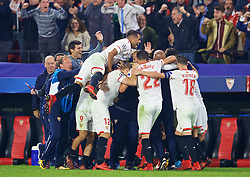 SEVILLE, SPAIN - Tuesday, November 21, 2017: Sevilla players celebrate with their head coach Eduardo Berizzo [hidden] after an injury-time equalising goal sealed a dramatic 3-3 draw, the coach had revealed to his players he had been diagnosed with prostate cancer during the half-time team-take when his side were losing 3-0, during the UEFA Champions League Group E match between Sevilla FC and Liverpool FC at the Estadio Ramón Sánchez Pizjuán. (Pic by David Rawcliffe/Propaganda)