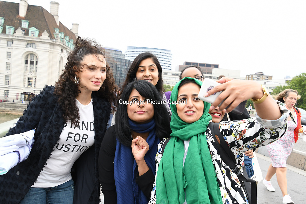 Huda Elmi,Fatima Rajina,Malia Bouattia, Maz Saleem,Zarah Sultana and Heena Khaled of Muslimahs Resist Trump upon his state visit to the UK, with a big banner hanging from Westminster Bridge, London (UK) on 12 July 2018.