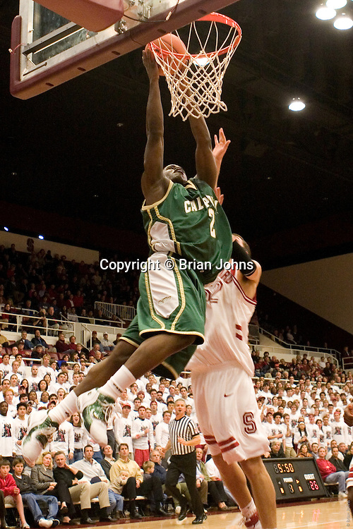 Cal Poly's Dawin Whiten dunks during The Mustangs'  58-82 loss to The Cardinal.  November 28th, 2005