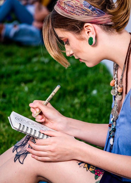 Em is drawing at Winston-Salem's ARTivity on the Green urban park just before the start of the Friday DADA Gallery Hop.