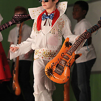 "Adam Robison | BUY AT PHOTOS.DJOURNAL.COM<br /> Cooper Bingham, as Elvis, a third grader at Saltillo Elementary School, performs ""All Shook Up"" as he helps represent Mississippi in the Shcool's Santa Tracker program Wednesday morning in the School's multipurpose building. The program covered types of weather and climates in different locations throughout the world and weather tools. The school used items in the program that were purchased with an ExPECT grant."