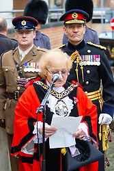 Mayor of Haringey Gina Adamou addresses the gathering as the London Borough of Haringey and representatives of the Armed Forces honour Lieutenant-Colonel Sir Brett Mackay Cloutman VC MC KC with the unveiling of the final London Victoria Cross Commemorative paving stone in Hornsey, London. November 06 2018.