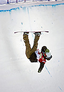 Alexandra Duckworth of Canada goes headfirst back into the halfpipe after catching an edge during qualifying for the halfpipe finals at the Chevrolet U.S. Snowboard Grand Prix in Breckenridge, Co. Saturday December 17, 2005. The Breckenridge event was the first of three stops in a series that will determine who will make the U.S. Snowboard Team and represent the country in the 2006 Winter Olympics in Torino, Italy. Shaun White of Carlsbad, Ca. won the men's event while Gretchen Bleiler of Snowmass Village, Co. won the women's event. The Grand Prix, now in its 10th year as the premier snowboard series in North America, features a cash purse of $340,000 and a new Chevrolet truck to the overall male and female winner of the series. Duckworth was helped out of the halfpipe and didn't qualify for the finals..(MARC PISCOTTY/ © 2006)