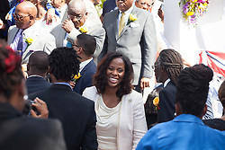 Congresswoman Stacey Plaskett exits the ceremony greeting many along the way.  St. Thomas Swearing-In Ceremony for the 32nd Legislature of the US Virgin Islands.  Emancipation Garden.  St. Thomas, VI.  9 January 2017.  © Aisha-Zakiya Boyd