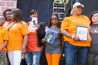 """Organizations pushing to get rid of gun violence came together Saturday afternoon, June 5th, 2017 for the Party for Peace, an event designed to raise awareness about issues related to gun violence by using live music and education. This event was held in Washington Park located at 51st and Hyde park Blvd and was sponsored by the organization Everytown for Gun Safety.<br /> <br /> 6699, 7008, 7009, 7012 – Parents and other family member of young people who were killed by gun violence were invited to stand in solidarity during the event. Many of them held pictures of their loved ones.<br /> <br /> Please 'Like' """"Spencer Bibbs Photography"""" on Facebook.<br /> <br /> All rights to this photo are owned by Spencer Bibbs of Spencer Bibbs Photography and may only be used in any way shape or form, whole or in part with written permission by the owner of the photo, Spencer Bibbs.<br /> <br /> For all of your photography needs, please contact Spencer Bibbs at 773-895-4744. I can also be reached in the following ways:<br /> <br /> Website – www.spbdigitalconcepts.photoshelter.com<br /> <br /> Text - Text """"Spencer Bibbs"""" to 72727<br /> <br /> Email – spencerbibbsphotography@yahoo.com"""