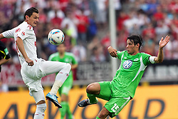 06.08.2011,  Rhein Energie Stadion, Koeln, GER, 1.FBL, 1. FC Koeln vs Vfl Wolfsburg, im Bild.Zweikampf zwischen Milivoje Novakovic (Koeln #11) gegen Christian Träsch / Traesch (Wolfsburg #15)..// during the 1.FBL, 1. FC Koeln vs Vfl Wolfsburg on 2011/08/06, Rhein-Energie Stadion, Köln, Germany. EXPA Pictures © 2011, PhotoCredit: EXPA/ nph/  Mueller *** Local Caption ***       ****** out of GER / CRO  / BEL ******