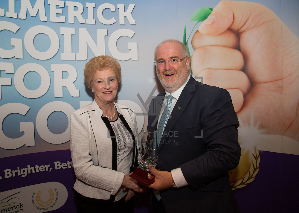 11.10.2016         <br /> The West of Limerick is awake and celebrating after Glin was announced as overall winner of Limerick Going for Gold 2016.<br /> Christine Ronan, Pallasgreen is presented with 1st runner up in the Limerick Going For Gold Most Beautiful Front Garden award from Roger Beck, Manager Parkway Shopping Centre.. Picture: Alan Place