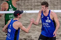 04-01-2018 NED: DELA Beach Open day 2, Den Haag<br /> Christiaan Varenhorst NED #1 en Jasper Bouter NED #2 winnen hun eerste partij met 2-0 van het Australische koppel McHugh/Schumann