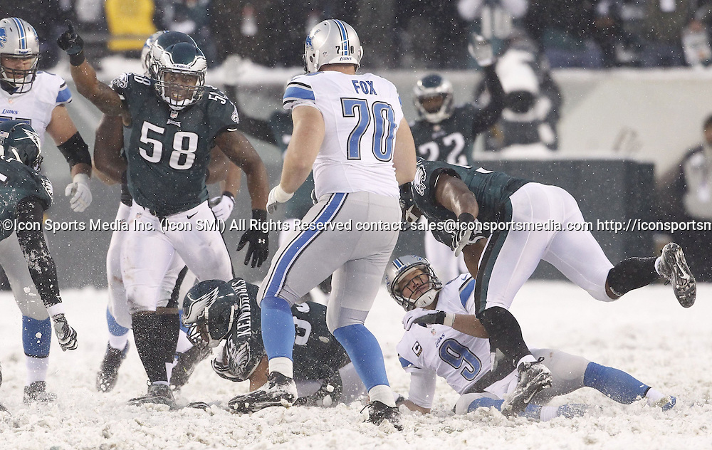 Dec. 8, 2013 - Philadelphia, PA, USA - Philadelphia Eagles Trent Cole (58) celebrates after Mychal Kendricks recovers a fumble by Detroit Lions quarterback Matthew Stafford, right, during the fourth quarter at Lincoln Financial Field in Philadelphia on Sunday, Dec. 8, 2013. The Eagles won, 34-20