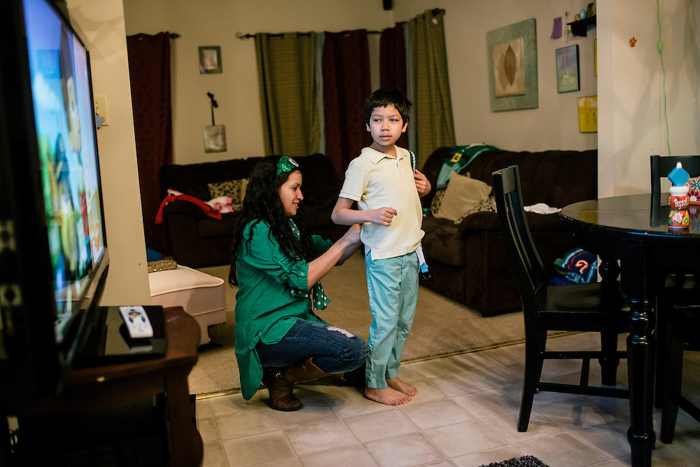 Larissa Camilleri puts suspenders on her son Eric, 8, early in the morning before school on March 17, 2015. Camilleri's husband, Matthew, is in the Army, and when they moved to DC from Germany, Camilleri was pregnant with their third child, Scarlett. Instead of looking for housing in the competitive DC market, they moved into housing on the Joint Base Anacostia-Bolling in a few days.