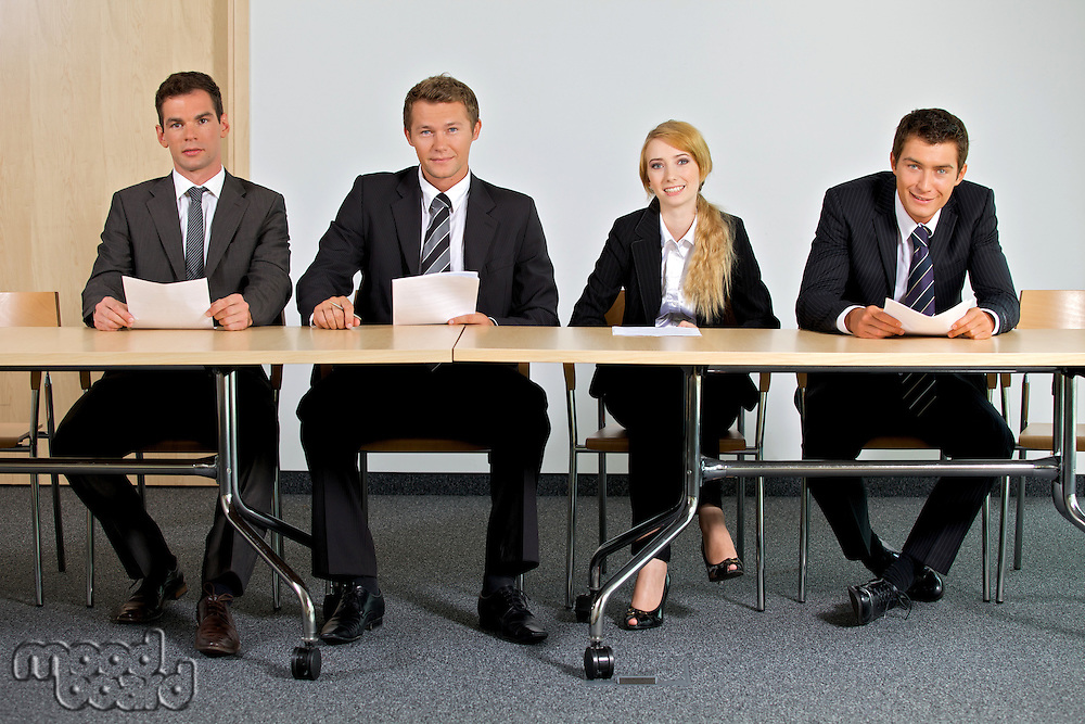Portrait of business people sitting in office