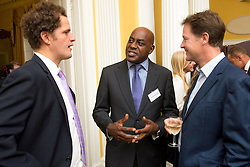 © Licensed to London News Pictures. 03/09/14. Admiralty House, Whitehall, London. Celebratory chefs Valentine Warner (left) and Ainsley Harriott (middle) were among the guests at the Deputy Prime Minister Nick Clegg's reception to celebrate the launch of the free school meals campaign. Photo credit : David Tett/LNP