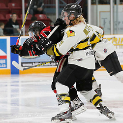 TRENTON, ON  - MAY 5,  2017: Canadian Junior Hockey League, Central Canadian Jr. &quot;A&quot; Championship. The Dudley Hewitt Cup. Game 7 between The Georgetown Raiders and The Powassan Voodoos. Gary Mantz #9 of the Powassan Voodoos battles with a Georgetown Raiders player during the first period<br /> (Photo by Amy Deroche / OJHL Images)
