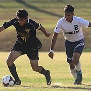 Newark FC Forward Diego Guzman (10) dribblesthe ball past Delcastle Salvador Munoz (2) during a regular season soccer match between Newark and Delcastle Thursday, Oct. 22, 2015 at Delcastle in Wilmington.