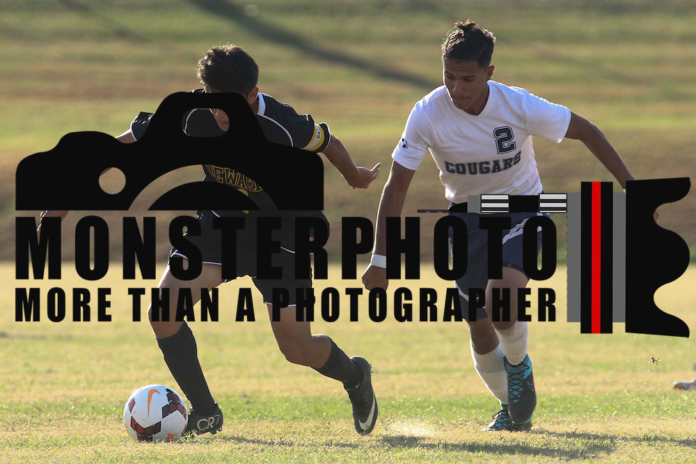 Newark FC Forward Diego Guzman (10) dribbles the ball past Delcastle Salvador Munoz (2) during a regular season soccer match between Newark and Delcastle Thursday, Oct. 22, 2015 at Delcastle in Wilmington.
