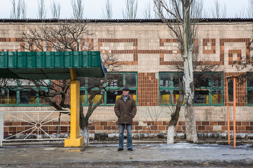 GORLOVKA, UKRAINE - JANUARY 31, 2015: A man waits at a bus stop in Gorlovka, Ukraine. Fighting in Ukraine has intensified over the last week, with rebels declaring the end of a September ceasefire. CREDIT: Brendan Hoffman for The New York Times