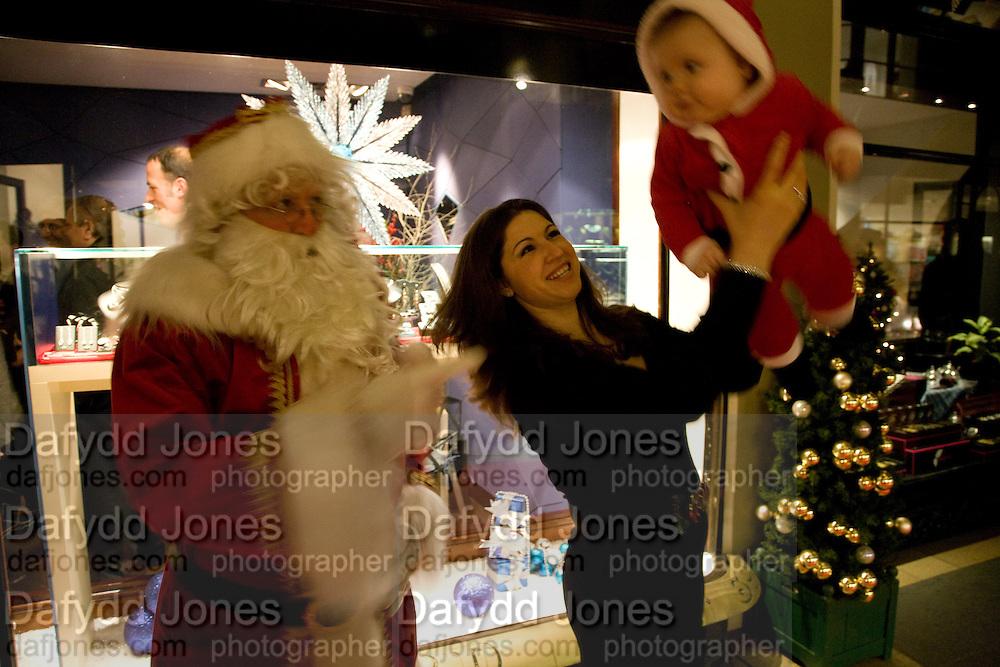 FATHER XMAS; BRUNILDA KRASNIQI; DAVID KRASNIQI, Patsy Kensit turns on Burlington Arcade Christmas Lights, Burlington Arcade, London, W1. 26 November 2008 *** Local Caption *** -DO NOT ARCHIVE -Copyright Photograph by Dafydd Jones. 248 Clapham Rd. London SW9 0PZ. Tel 0207 820 0771. www.dafjones.com