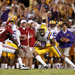 November 3, 2012; Baton Rouge, LA, USA; LSU Tigers wide receiver Odell Beckham (3) is pursued by Alabama Crimson Tide defensive back Nick Perry (27) during a game at Tiger Stadium. Alabama defeated LSU 21-17. Mandatory Credit: Derick E. Hingle-US PRESSWIRE