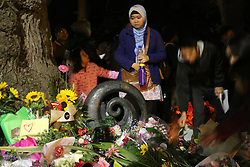March 16, 2019 - Christchurch, New Zealand - Indonesian community members seen paying respect to the victims of the Christchurch mosques shooting. Around 50 people has been reportedly killed a terrorist attack on two Christchurch mosques. (Credit Image: © Adam Bradley/SOPA Images via ZUMA Wire)