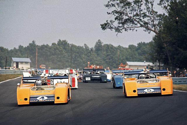 "McLaren M20 team mates Peter Revson (on pole in no. 4) and Denny Hulme (race winner in no. 5) pace the start of the 1972 Watkins Glen Can-Am; this would be the last series victory for the once-dominant ""Kiwi"" team, and in fact the last race the pair would start from the front row; PHOTO BY Pete Lyons 1972 / www.petelyons.com"