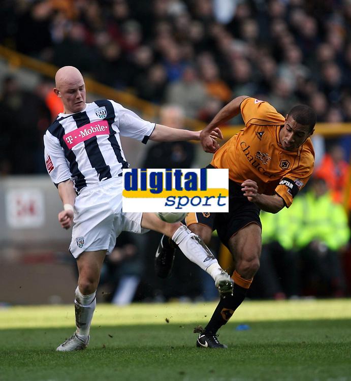 Photo: Rich Eaton.<br /> <br /> Wolverhampton Wanderers v West Bromwich Albion. The FA Cup. 28/01/2007. West Broms Richard Chaplow left,and Wolves captain Karl Henry clash