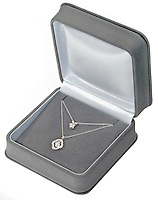single strand diamond necklace in a jewelry box