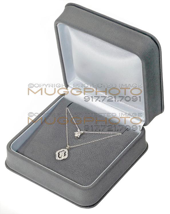 single strand diamond necklace in a jewelry box