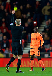 STOKE-ON-TRENT, ENGLAND - Wednesday, November 29, 2017: Liverpool's Sadio Mane is shown a yellow card during the FA Premier League match between Stoke City and Liverpool at the  Bet365 Stadium. (Pic by David Rawcliffe/Propaganda)