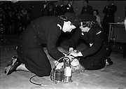 31/03/1963<br /> 03/31/1963<br /> 31 March 1963<br /> Civil Defence Competitions at Jervis Street Hospital, Dublin sponsored by W.D. & H.O. Wills Ltd.. Winning team leader, Miss Frances Todd (left) and Miss Carmel Doyle at work on a casualty.