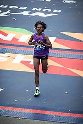 Tigist Tufa, Ethiopia, crossed finish line in 3rd