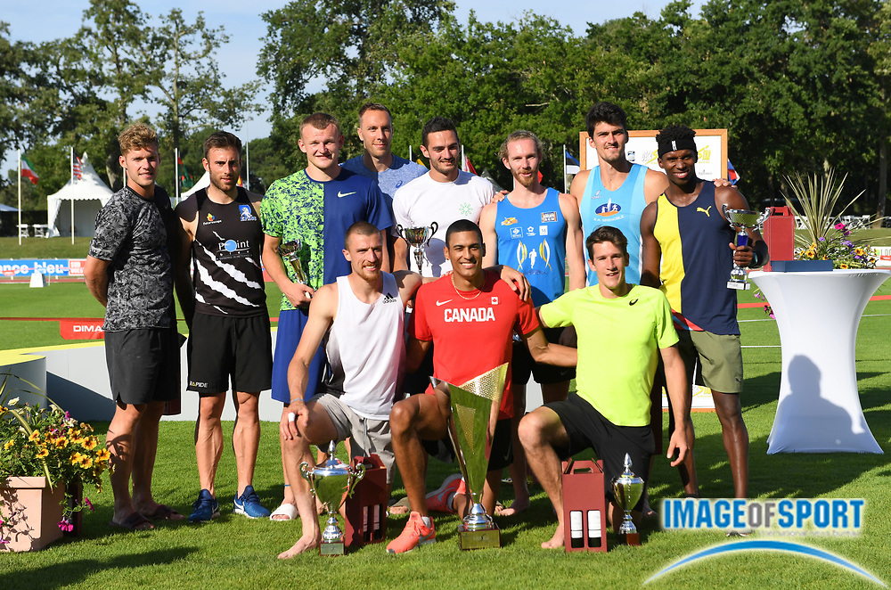 Pierce LePage (CAN), center, poses with runner-up Zach Ziemek (USA), left, and third-place finisher Thomas Van Der Plaetsen (BEL) and competitors after winning the decathlon with 8,453 points during the decathlon at the DecaStar meeting, Saturday, June 23, 2019, in Talence, France. (Jiro Mochizuki/Image of Sport)