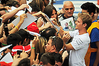 Nico Rosberg (GER) Mercedes AMG F1 signs autographs for the fans.<br /> Italian Grand Prix, Thursday 4th September 2014. Monza Italy.