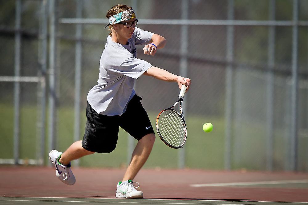Lake City High's Matt Gencarella races toward a short shot from the Lewiston High doubles team Saturday during the 5A Region 1 tournament.