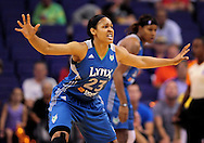 Sep 25, 2011; Phoenix, AZ, USA; Minnesota Lynx forward Maya Moore (23) reacts on the court while playing Phoenix Mercury at the US Airways Center. The Lynx defeated the Mercury 103-86. Mandatory Credit: Jennifer Stewart-US PRESSWIRE