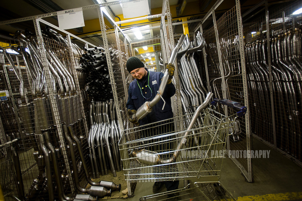 A factory worker tends to stock at the BM Catalysts factory on February 6, 2013, in Mansfield, England. (Photo by Warrick Page)