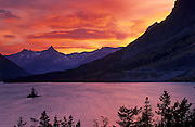 A fiery sunset in one of the most iconic landscapes of Glacier National Park, Montana
