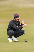 Tommy Fleetwood lines up a putt during the final round of the Alfred Dunhill Links Championships 2018 at West Sands, St Andrews, Scotland on 7 October 2018
