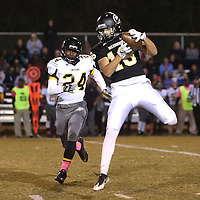 Lauren Wood | Buy at photos.djournal.com<br /> Pontotoc's Ryne Franklin makes a catch while loosely defended by Itawamba's Krayshawn Middlebrook during Friday night's game at Pontotoc.