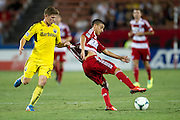 FRISCO, TX - SEPTEMBER 29:  Mauro Diaz #20 of FC Dallas has his jersey held by Will Trapp #20 of the Columbus Crew on September 29, 2013 at Toyota Stadium in Frisco, Texas.  (Photo by Cooper Neill/Getty Images) *** Local Caption *** Mauro Diaz; Will Trapp