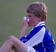 Donaghmore/Ashbourne vs Skryne u-12 football league final at Pairc Tailteann_11/06/10.Skryne half back, Daniel Fitzpatrick shows the signs of battle as he tries to stop a nose bleed..Photo: David Mullen /www.cyberimages.net