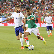 Giovani Dos Santos, (right), Mexico, gets past Miguel Veloso, Portugal, during the Portugal V Mexico International Friendly match in preparation for the 2014 FIFA World Cup in Brazil. Gillette Stadium, Boston (Foxborough), Massachusetts, USA. 6th June 2014. Photo Tim Clayton