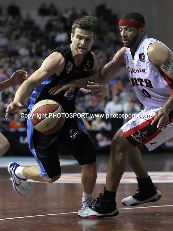 Breakers' Kirk Penney drives past Wildcats' Andre Brown. iinet ANBL, Semi-Finals Game 1, New Zealand Breakers vs Perth Wildcats, North Shore Events Centre, Auckland, New Zealand. Thursday 7th April 2011. Photo: Anthony Au-Yeung / photosport.co.nz
