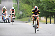 "Craig ""Crowie"" Alexander leads the way to a victory at Ironman 70.3 in Lake Stevens,WA on July 21, 2013. (Charles Hall/challphotos.com)"