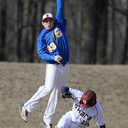 Staff photos by Tom Kelly IV<br /> Springfield third baseman Nick Gorman (33) stretches for the high throw from home plate, as O'Hara's Isiah Hammond (11) steals third base during the Springfield at Cardinal O'Hara baseball game on Tuesday afternoon, March 24, 2015.